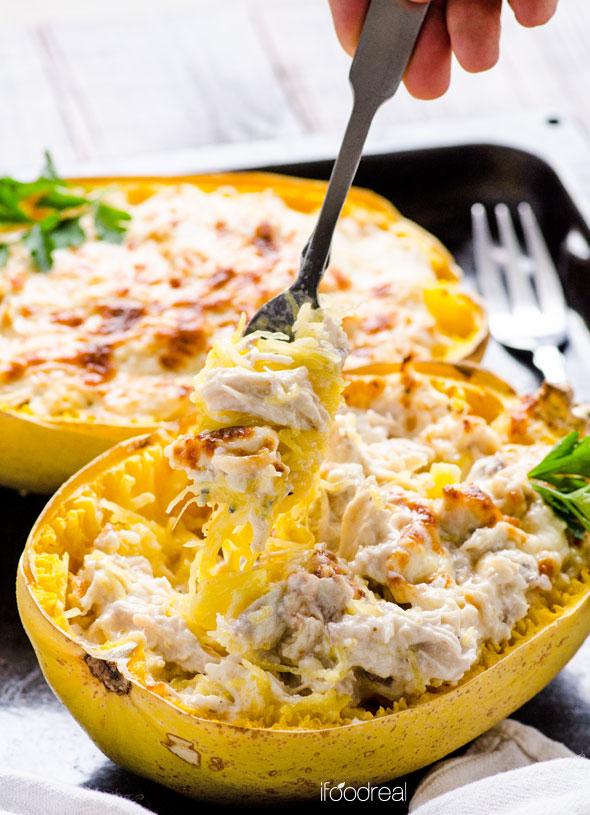 holding-greek-yogurt-chicken-alfredo-spaghetti-squash-boats-recipe
