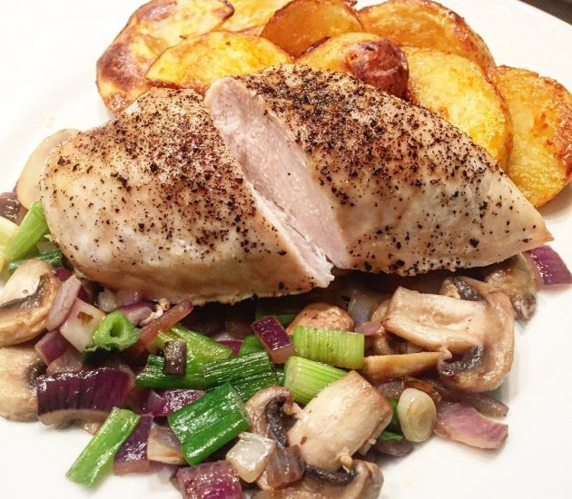 chicken-marinated-and-cooked-in-black-pepper-chilli-mushroomsspring-and-red-onions-served-with-homemade-grilled-potato-wedge