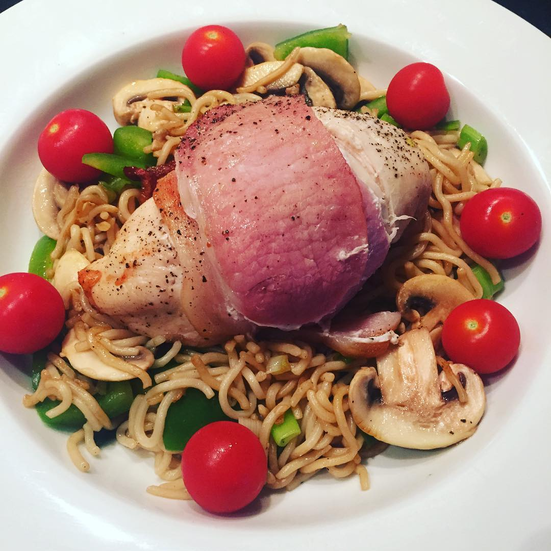 chicken-wrapped-in-bacon-medallions-served-with-whole-meal-noodles-and-mixed-vegetables