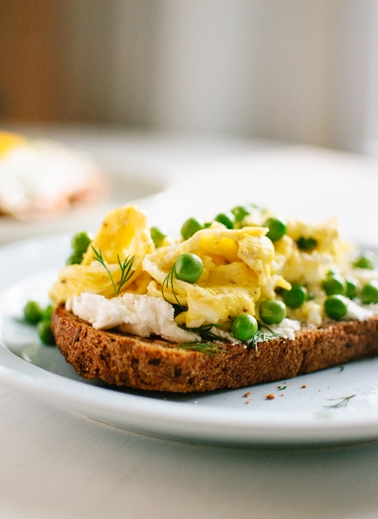 Goat Cheese Slathered On Whole Grain Toast Topped With An Egg Fried Or Scrambled And A Sprinkling Of Fresh Peas Herbs